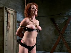 horny redhead's tied up as her master toys with her