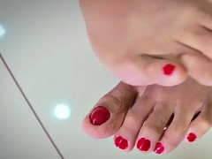 solo ladyboy showing pedicured feet