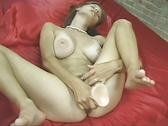 Skinny naked chck plays with her honey pot