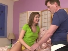 A brunette is getting cum in her pretty little mouth in this video