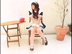 Attractive Oriental maid in white pantyhose sensually touch