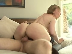 A mature cougar that loves young men gets her pussy rammed
