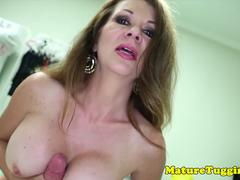 Amateur mature tugging cock with both hands