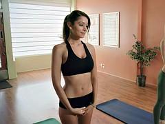Yoga teacher teaching new yoga exercises to stay fit