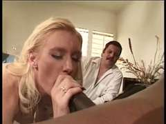 Lengthy haired light-haired makes enjoy to a ebony dick with her throat