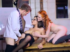 Busty pornstar and redhead cutie 3some action on a desk
