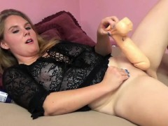 Busty wife Dani Arcadia is fucking her twat with a big toy