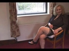 Big breasts grown-up woman in slip and besides stockings