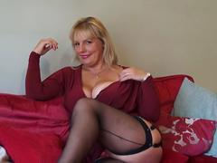 Horny housewife showing off her big tits