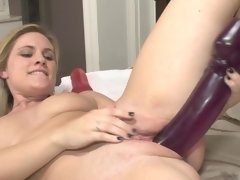 This blonde that loves her dildos is jacking off on the bed today
