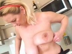 boobsy old female plays in the kitchen and besides shower