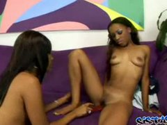 Lesbian babe gets her pussy fucked using a red dildo