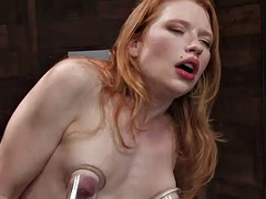 kinky redhead's fucked by machines in a bondage scene