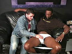 muscular guy with a beard gets banged by black men