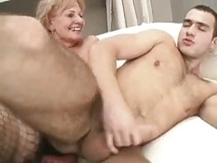 More experienced dudey uses strapon on younger dude