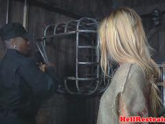 BDSM sub dominated in pillory before group