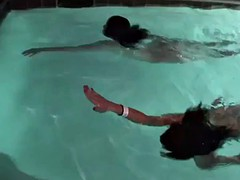 Two brunettes get naughty in the pool