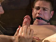 dominatrix bitch whips a guy into shape