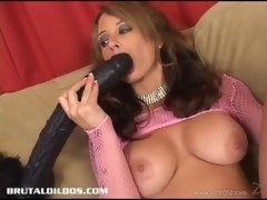solo model caresses her titties then sinks the massive dildo down her twat