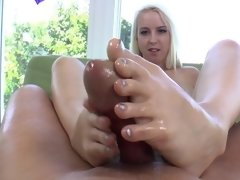 A sweet and sexy blonde enjoys using her hot little legs on a dick