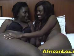 Two black African lesbians having fun during pussy licking in 69 pose