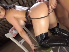 A chick with an amazing rack is getting pounded in the warehouse