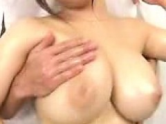 Voluptuous Asian lady has a horny boy kissing her huge natu
