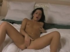 Kinky brunette prepares for bed by masturbating passionately