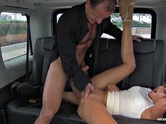 Blonde hottie with glasses is up for a quickie in the taxi while still wearing her dress