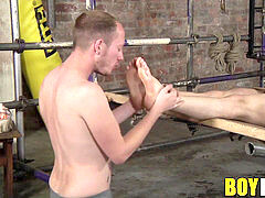 Bound twink marionette gives his tormentor an unwilling soles fuck